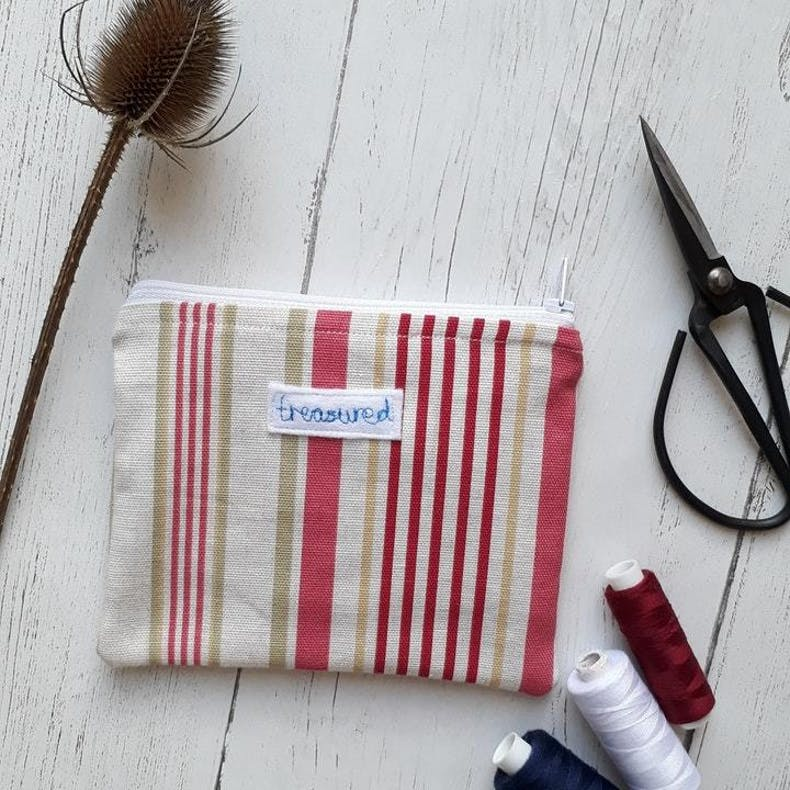 Treasured Christian Makeup Bag with red stripes and embroidered text