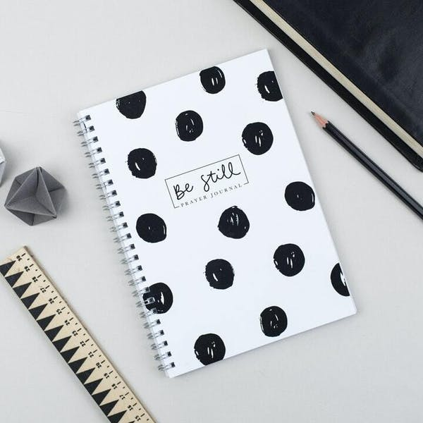 Ali Marriott Be Still Prayer Journal with white cover and black spots, spiral bound, at Cheerfully Given