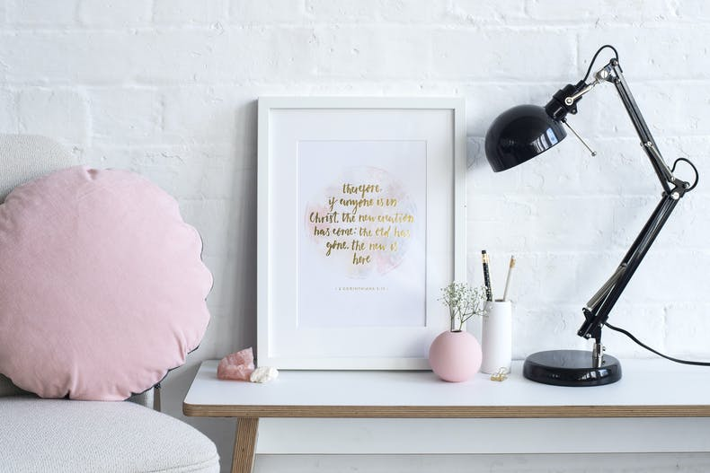Gold Scripture artwork on desk at Cheerfully Given