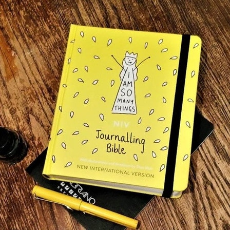 Yellow I Am So Many Things Journaling Bible on a wooden desk by I Am So Many Things @ Cheerfully Given