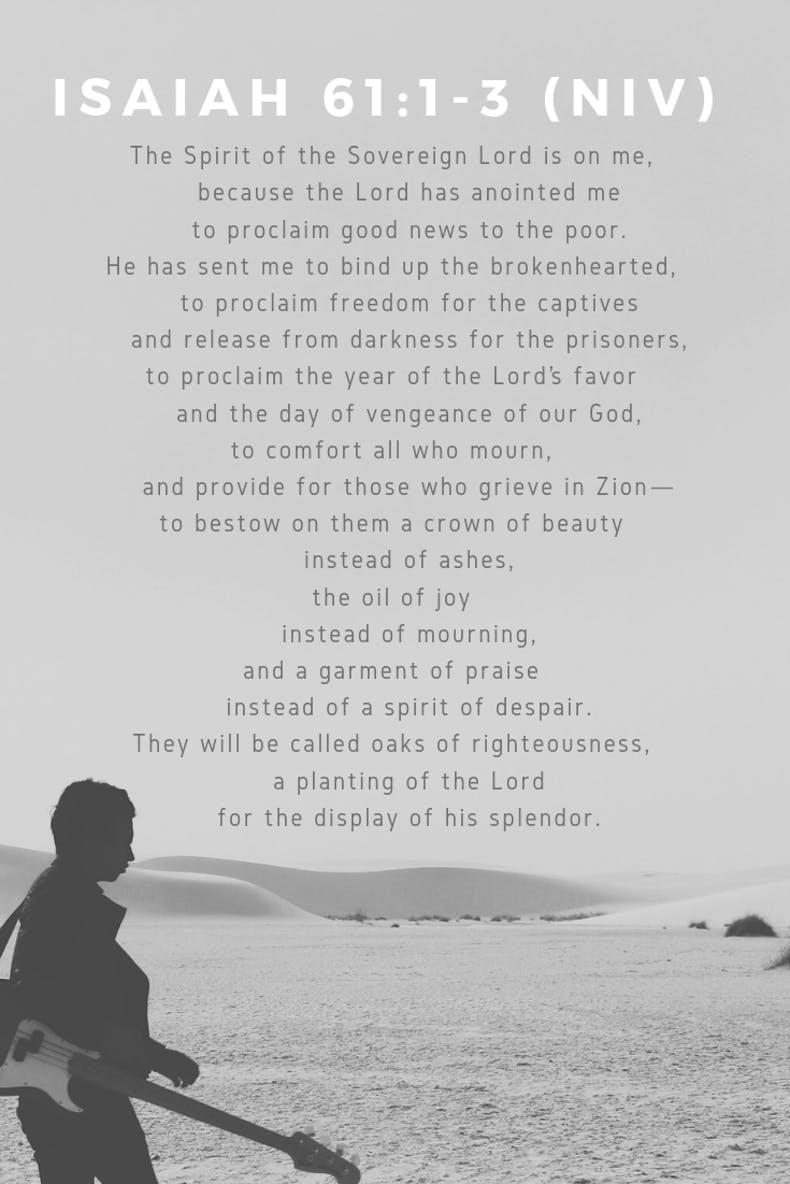 Isaiah 61 Scripture on b&w scene of guitarist next to sea