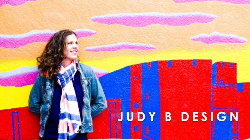 Judy B Design in front of graffiti wall at Cheerfully Given