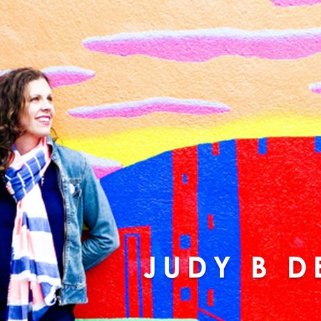 Judy B Design in front of graffiti wall at Cheerfully Given