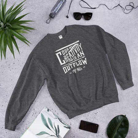 Flatlay of Grey Our Creativity is an Outflow of His Christian Sweatshirt by Laurent Collective | Cheerfully Given