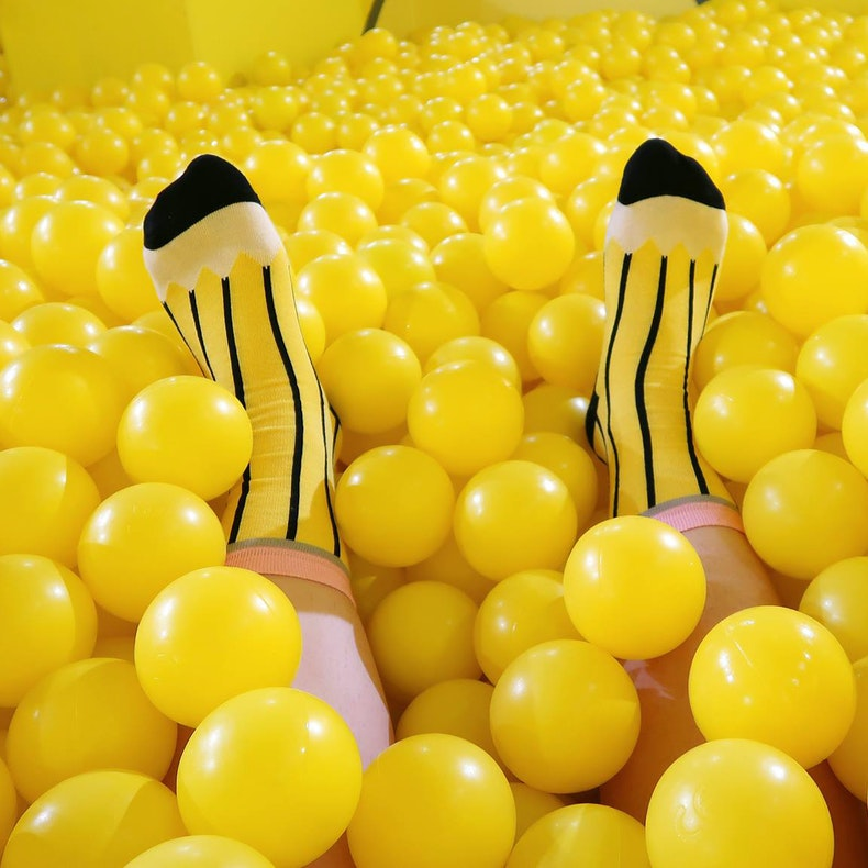 Bright Yellow Pencil Socks in a yellow ball pit | Cheerfully Given