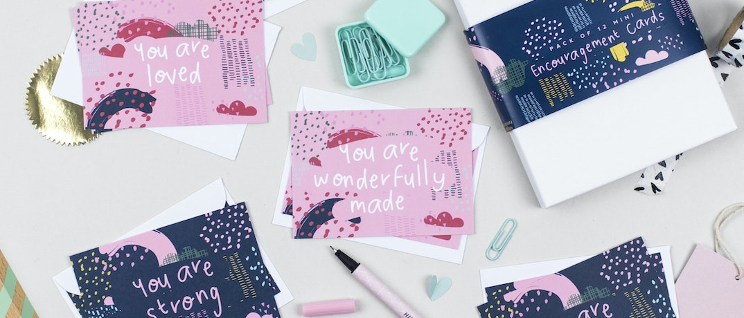 Pink and navy Christian cards set laid on a table by Ali Marriott @ Cheerfully Given