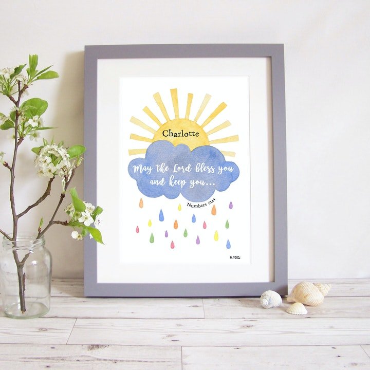 A cloud and sunshine framed watercolour print with the words 'May the Lord bless you and keep you' written in the cloud by Alice and the Mustard Seed