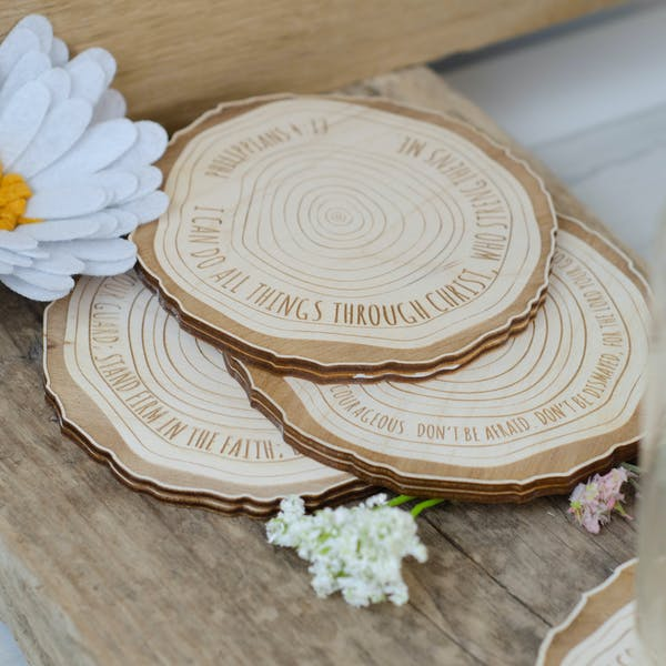 Engraved Scripture wood slice coasters on rustic table with flowers | Made by Birch and Tides @ Cheerfully Given