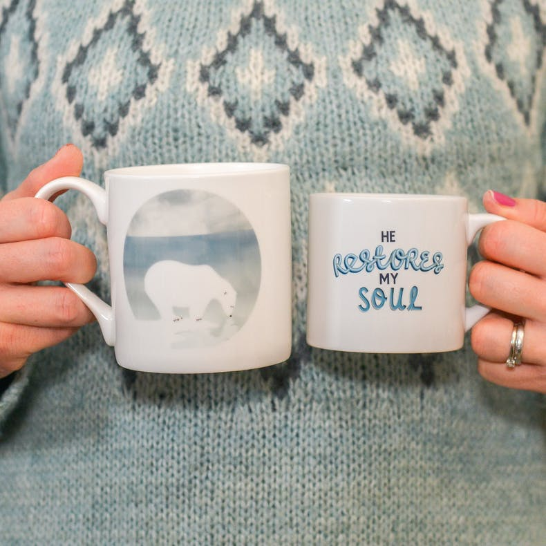A polar bear parents touching noses with a baby polar bear mug with the words He restores my soul on the back | Made by Frog and Gnome | Cheerfully Given