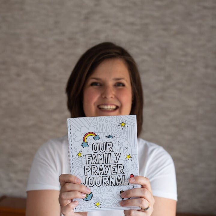 Cath Sales holding spiral bound Our Family Prayer Journal | Made by Hope and Ginger @ Cheerfully Given