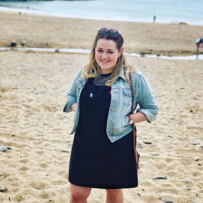 Jordan Lily Designs standing on beach in Cornwall | Cheerfully Given