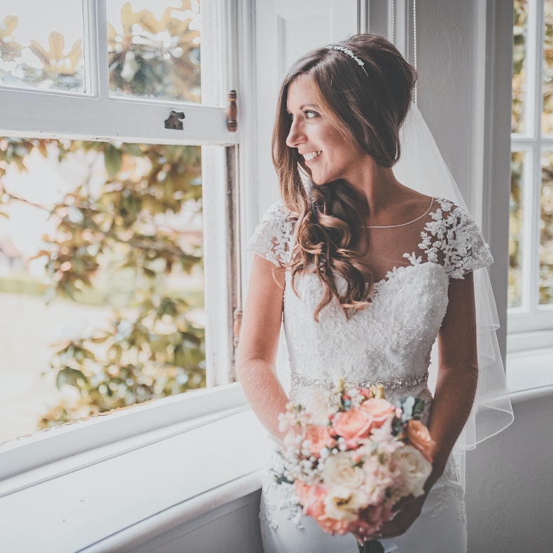 Ruth Don in wedding dress holding peach flowers | Streten | Cheerfully Given