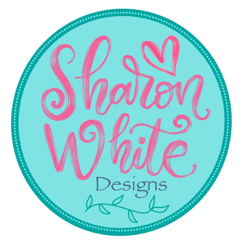 Sharon White Designs Turquoise and Pink Logo at Cheerfully Given