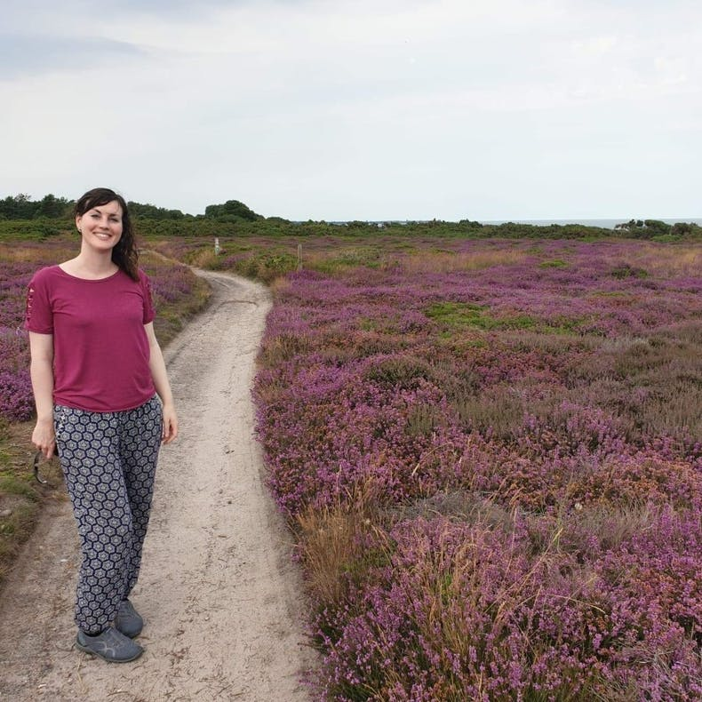 Sharon White stands on a heather moorland | Sharon White Designs | Cheerfully Given